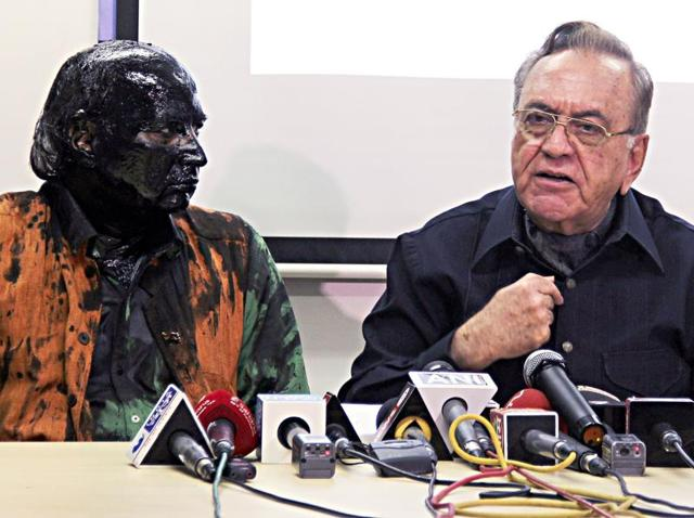 Indian activist Sudheendra Kulkarni (L), whose face was blackened by ink in an alleged attack, looks on as former Pakistani foreign minister Khurshid Mahmud Kasuri speaks to media in Mumbai.