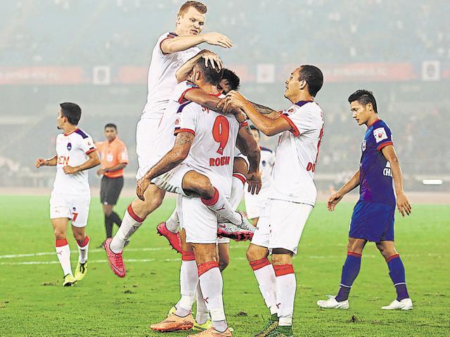 Delhi Dynamos players congratulate Robin Singh (No. 9) for scoring the equaliser during the ISL match against Mumbai City FC at the Jawaharlal Nehru Stadium in Delhi on November 6, 2015.