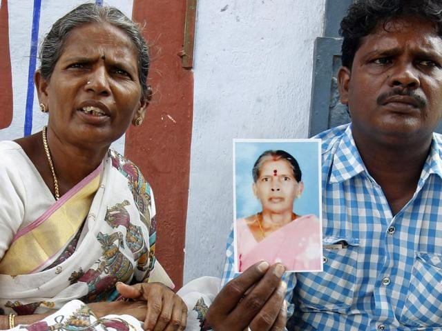Malliga, sister, and Mohan, son, of Kasturi Munirathinam, display the maid's photograph.