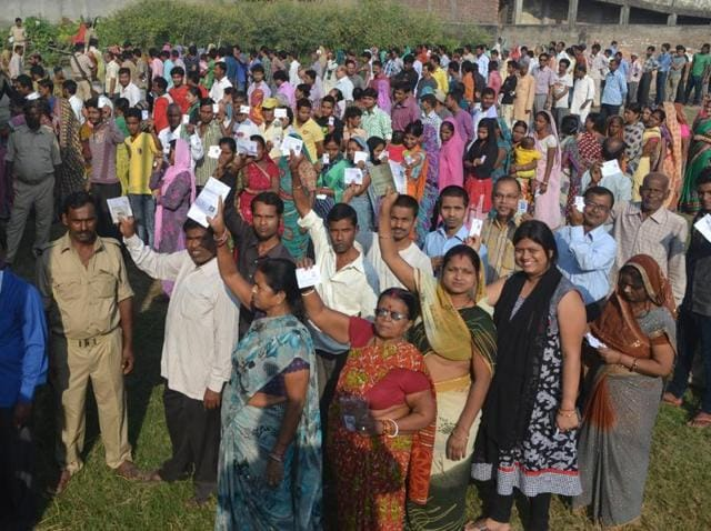 Voters assembled in large number before a polling station to use their voting power during 4th phase of Bihar assembly elections.