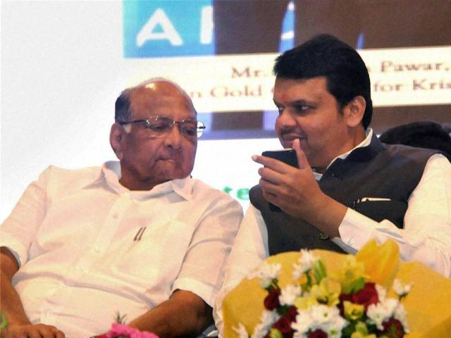 NCP chief Sharad Pawar with Chief Minister Devendra Fadnavis and others in a car at an Agriculture Exhibition in Baramati, Maharashtra on Friday.