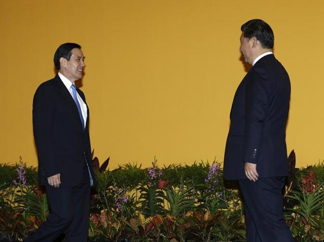 Chinese President Xi Jinping (R) and Taiwanese President Ma Ying-jeou (L) meet at the Shangri-la hotel. The two leaders shook hands at the start of a historic meeting, marking the first top level contact between the formerly bitter Cold War foes since they split amid civil war 66 years ago.