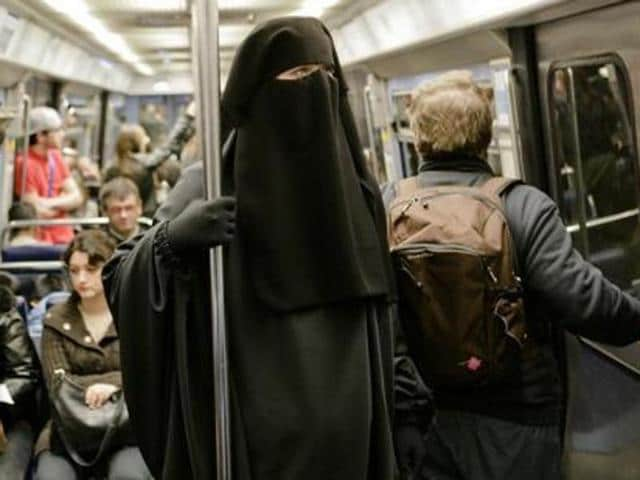 """A police team arrived at the scene and """"unmasked"""" the man, who was dressed in a full-length, Islamic-style black robe with a niqab covering his face."""
