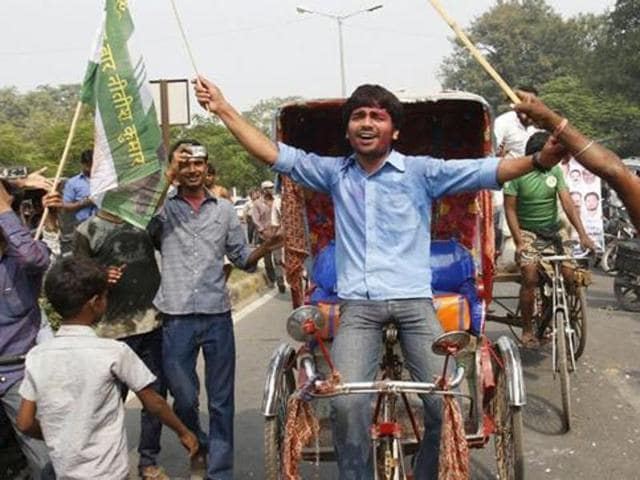 Supporters of the Grand Alliance celebrate in Patna.