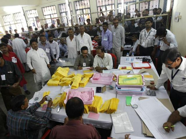 Poll officials count votes at a college in Patna.