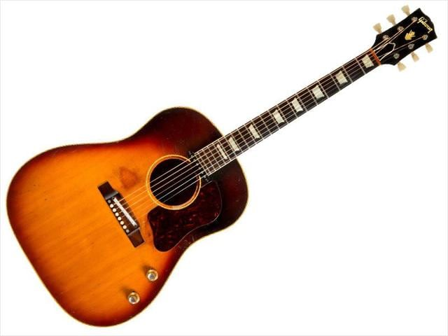 A 1962 J-160E Gibson acoustic guitar stolen from former Beatle John Lennon in the 1960s is pictured in this undated handout photo obtained by Reuters November 7, 2015.