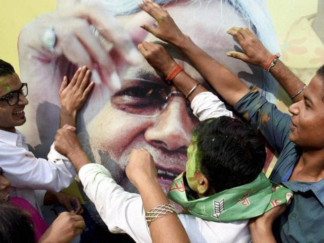 JD(U) supporters celebrate the Mahagathbandhan's victory in Bihar assembly elections in Patna.