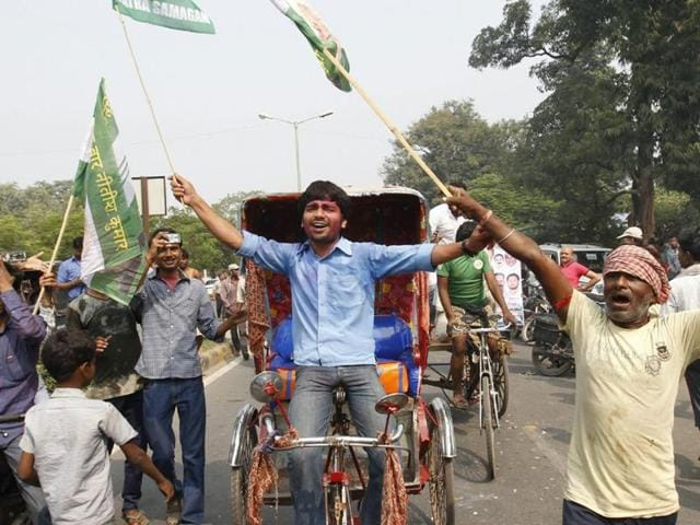 Supporters of the grand alliance celebrate after results of the Bihar Assembly elections are announced, in Patna.