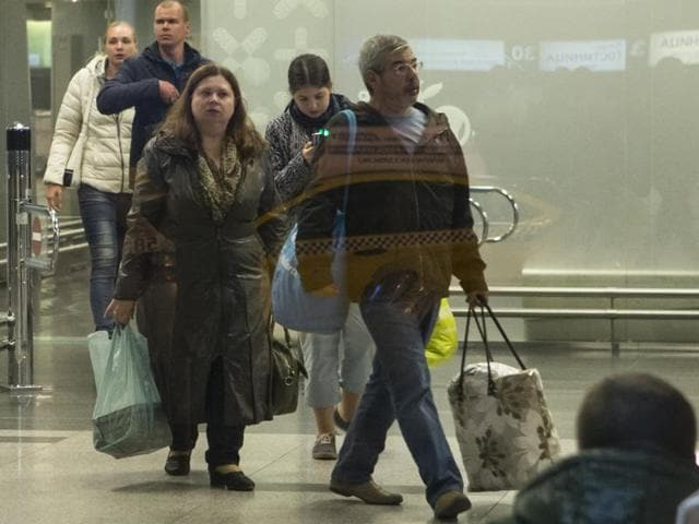 Passengers arrive from Egypt's Hurghada at Vnukovo airport outside Moscow, on November 7, 2015. Russia's deputy PM announced on Sunday that about 11,000 tourists had returned home from Egypt following suspension of flights to Egypt after the Sinai plane crash.