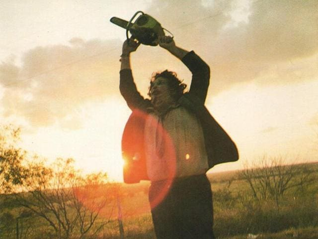 An iconic shot from an iconic film: Leatherface attacks.