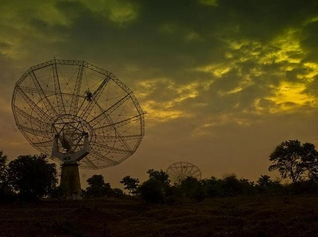 A photo taken from NCRA website shows a Giant Metrewave Radio Telescope (GMRT) at NCRA, Khodad in Pune.