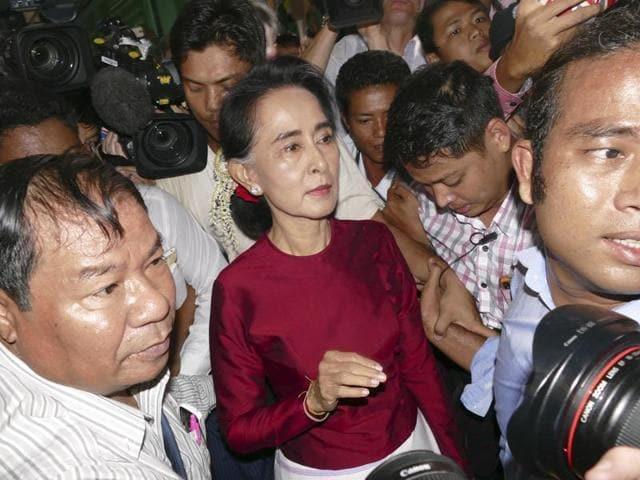 Myanmar opposition leader Aung San Suu Kyi leaves after casting her ballot at a polling station in general election in Yangon.