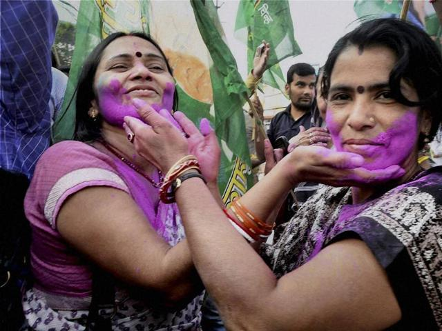 Supporters of Congress, RJD and JD(U) celebrate the Grand Alliance's victory in Bihar assembly elections in Ranchi on Sunday.