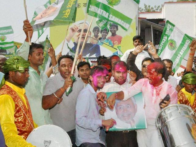 JD(U) supporters celebrate the Mahagathbandhan's victory in Bihar assembly elections in Patna on Sunday.