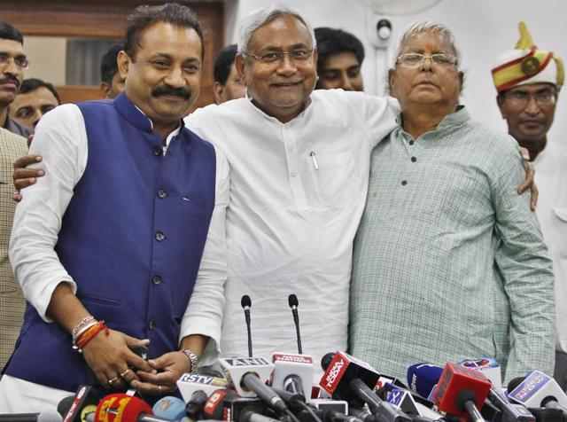 Janta Dal (U) leader Nitish Kumar and Rashtriya Janta Dal leader Lalu Prasad Yadav and Ashok Choudhary , president of the Bihar Pradesh Congress Committee at a press conference after victory in Bihar assembly election, in Patna on Sunday.