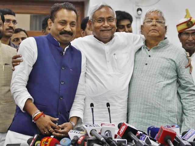 Bihar chief minister Nitish Kumar surrounded by media persons as he greets supporters after victory in Bihar state elections, in Patna on Sunday.