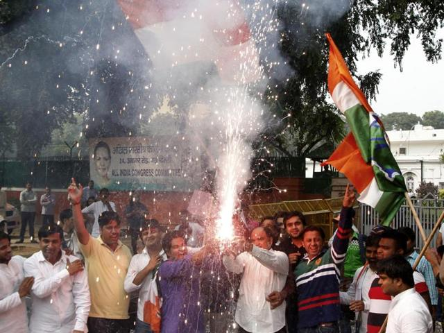 Congress workers celebrating after Bihar Assembly election results, at AICC, in New Delhi.