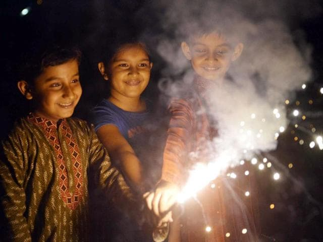 Children burst crackers to mark the arrival of Diwali, the festival of lights but marred by pollution.