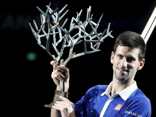 Novak Djokovic, right, holds the winner's trophy while Andy Murray holds the runners-up trophy after their final of the Paris Masters on November 8, 2015.