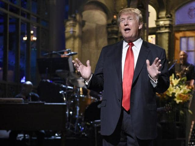 Republican presidential candidate Donald Trump, centre, with lookalikes Taran Killam, left, and Darrell Hammond perform during the monologue on 'Saturday Night Live' on November 7, 2015.