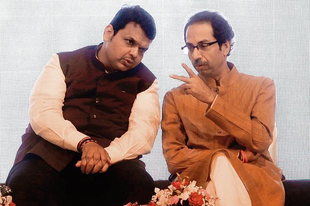 Maharashtra Chief Minister Devendra Fadnavis's government (L) has been under attack from his ally, Shiv Sena chief Uddhav Thackeray.