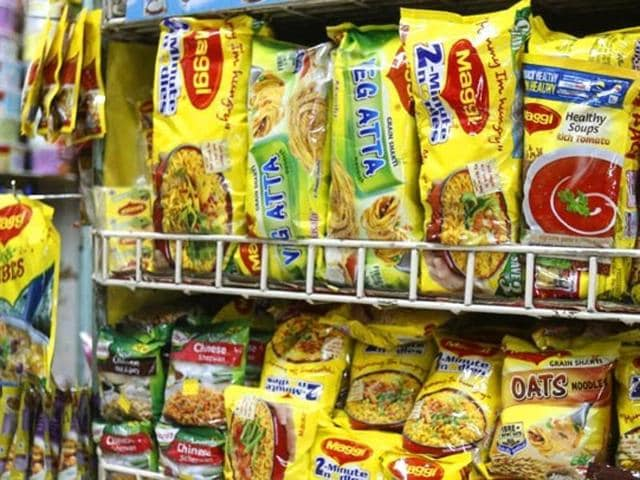 A file photo of a shopkeeper in Delhi holding packets of Maggi noodles.