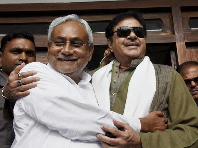 Actor and BJP MP Shatrughan Sinha in conversation with RJD supremo Lalu Prasad after his success in the Bihar elections, in Patna on Monday.