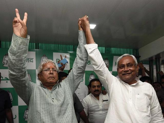 Lalu Prasad Yadav and Nitish Kumar celebrate their victory in Bihar elections, in Patna on Sunday.