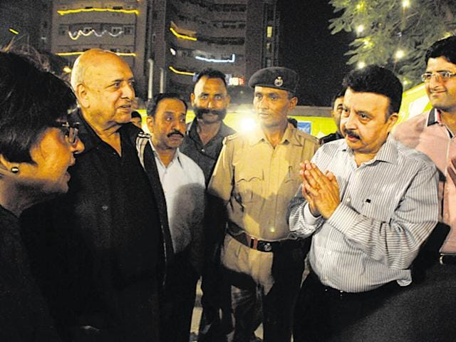 Haryana PWD minister Rao Narbir Singh (second from right) interacts with residents of condominiums along MG Road on Sunday.