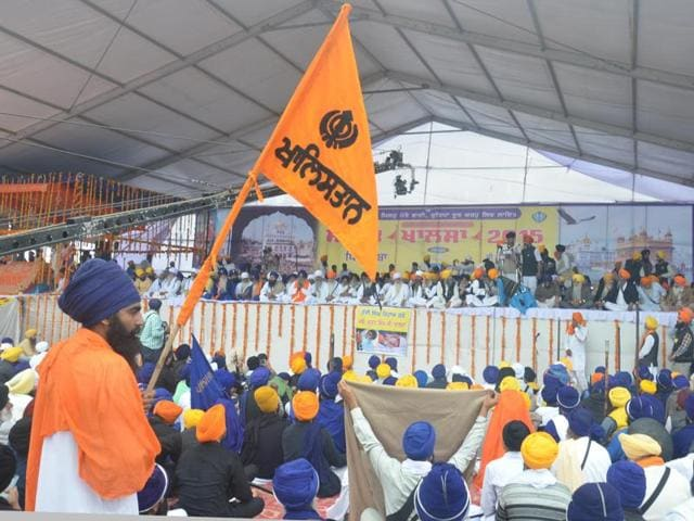 A Sikh youth holding a Khalistan flag during the radicals' Sarbat Khalsa at Chabba village in Amritsar on Tuesday.