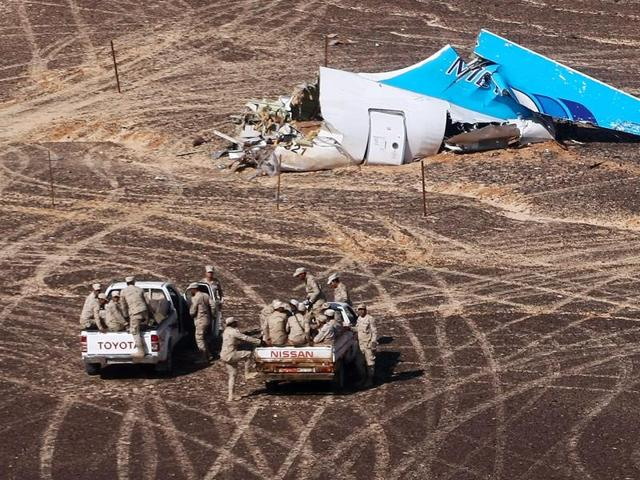 Egyptian Military on cars approach a plane's tail at the wreckage of a passenger jet bound for St. Petersburg in Russia that crashed in Hassana, Egypt, on Sunday.
