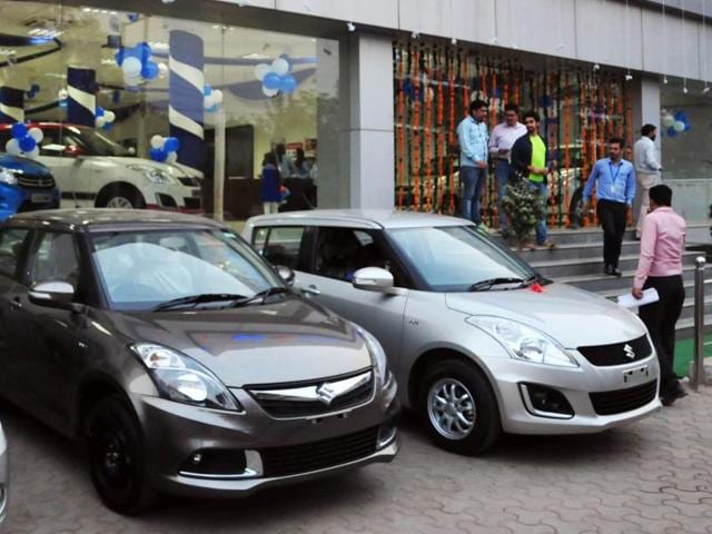 Buyers looking at new cars at a showroom in Chandigarh.