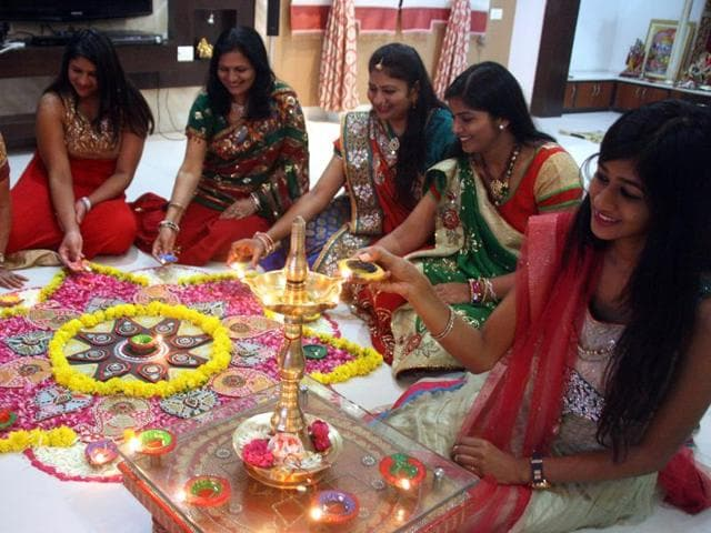Girls prepare Rangoli  a day ahead of Diwali in Indore on Tuesday.