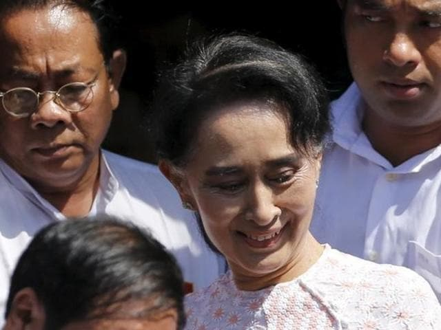 Myanmar's National League for Democracy party leader Aung San Suu Kyi leaves her party headquarters after talking to supporters about the general elections in Yangon, Myanmar November 9, 2015.