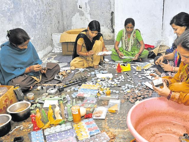 A group of women inmates in Dasna jail have been preparing candles of different varieties for sale during Diwali.
