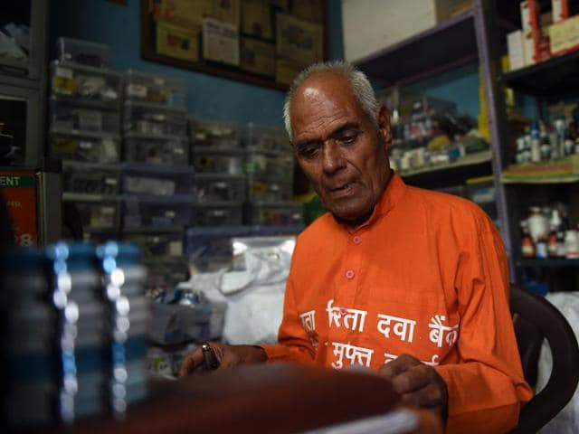 The 79-year-old calls to residents to bring out their medicines, rather than throw them away to donate to Delhi's millions of desperate poor.