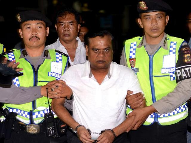 Indonesian police escort Rajendra Sadashiv Nikalje, 55, known as Chhota Rajan (C) from Bali Police headquarters to Ngurah Rai Airport during his deportation from Denpasar on Bali island.