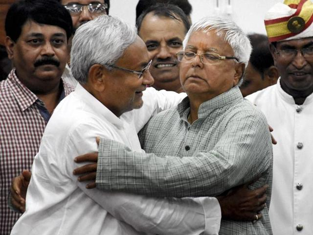 Bihar Chief Minister Nitish Kumar and RJD chief Lalu Prasad greet each other after Mahagathbandhan's (Grand Alliance) victory in Bihar assembly elections at RJD office in Patna on Sunday.