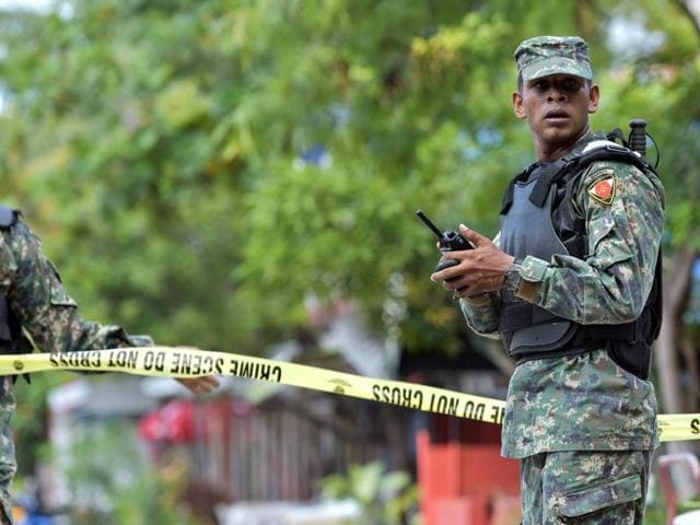 Maldives National Defense Force (MNDF) personnel patrol the streets after a state of emergency was declared in Male, Maldives, Wednesday, Nov. 4, 2015.