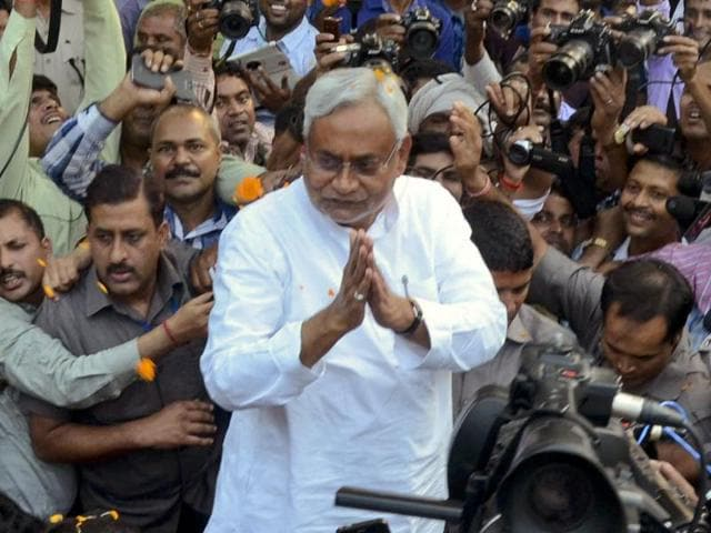 Nitish Kumar is surrounded by media personnel as he greets supporters after victory in Bihar elections.