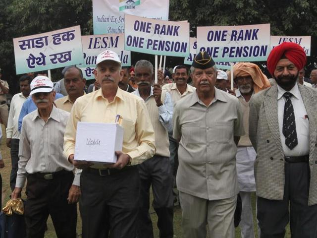Panchkula India Nov10 Veterans marching towards Panchkual DC office to deposit their medals against recent OROP notification by central government on Tuesday Photo Sant Arora Hindustan Times