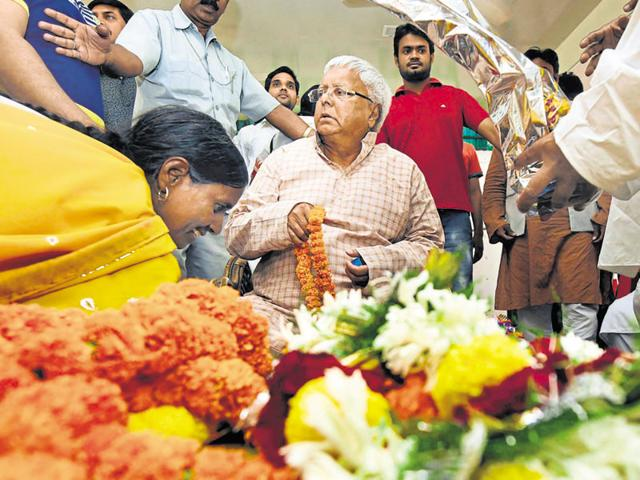 RJD chief Lalu Prasad meets his supporters at his residence in Patna on Monday.