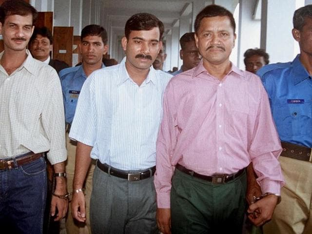 ULFA leader Anup Kumar Chetia (second from right) is handcuffed along with his two accomplices Babul Sharma (L) and Luxmi Prashad (C) as they arrive at a Bangladeshi court in Dhaka in 2002.