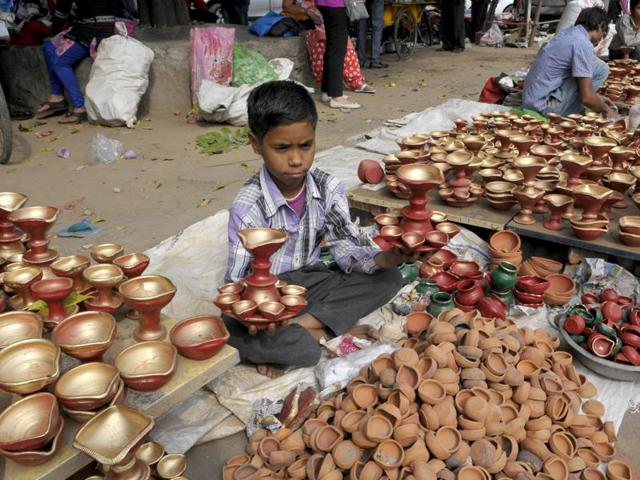 School children selling Diwali products at sector 22 market in Chandigarh on Tuesday, November 10, 2015.