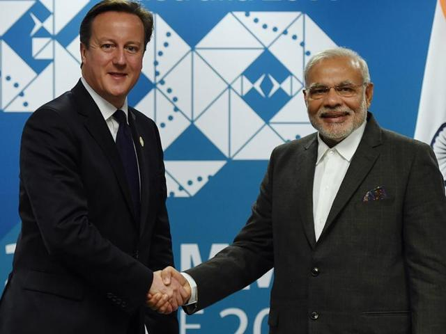 In this file photo, Britain's Prime minister David Cameron (L) shakes hands with Prime Minister Narendra Modi (R) during a bilateral meeting on the sidelines of the G20 Summit at the Brisbane Convention and Exhibitions Centre (BCEC) in Brisbane. Modi will begin his first visit to Britain as Prime Minister on November 12, 2015.