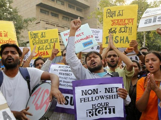 Students protest against the discontinuation of the non-NET scholarship for students undertaking research programmes outside the University Grants Commission (UGC) office  in New Delhi.