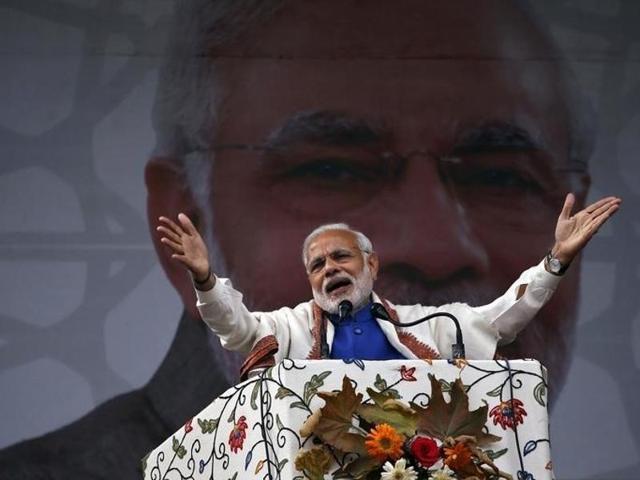 Prime Minister Narendra Modi addresses a rally in a cricket stadium in Srinagar.