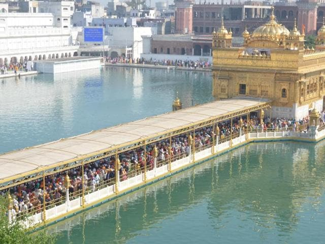 Devotees pay obeisance at Golden Temple on the occasion of Diwali festival in Amritsar on Wednesday .
