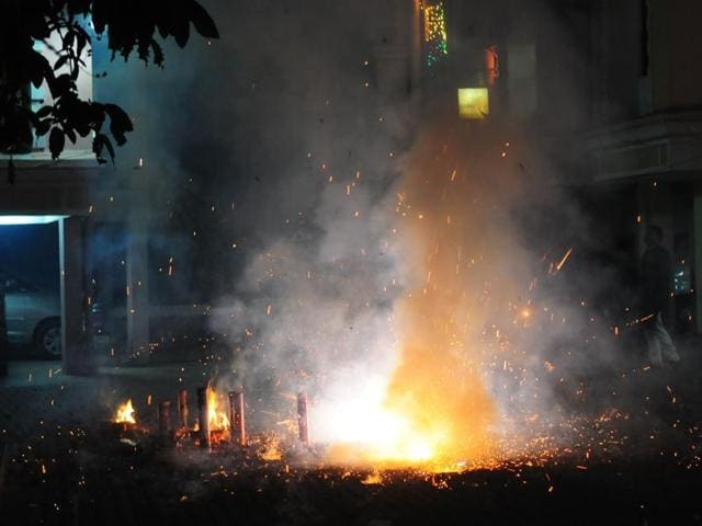 Heavy smoke pollutes the environment on Diwali night in Bhopal on Wednesday.