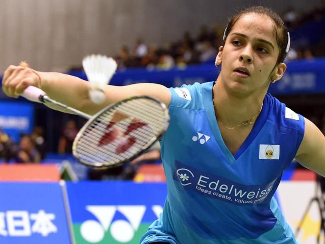 Saina Nehwal of India hits a return against Minatsu Mitani of Japan during their women's singles second round match at the Japan Open Superseries badminton tournament in Tokyo on September 10, 2015. AFP PHOTO / TOSHIFUMI KITAMURA